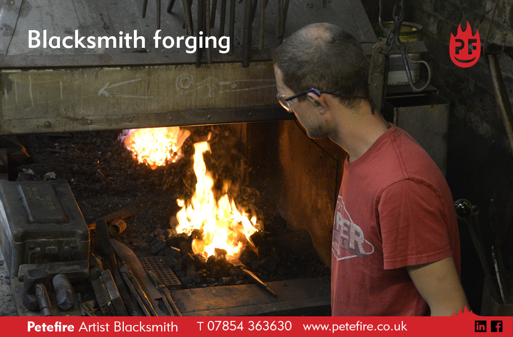 Petefire Artist Blacksmith, Watford. Hot forging a piece of metalwork