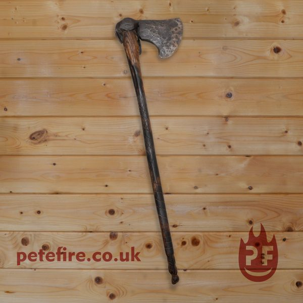 hand forged axe with carved wooden handle