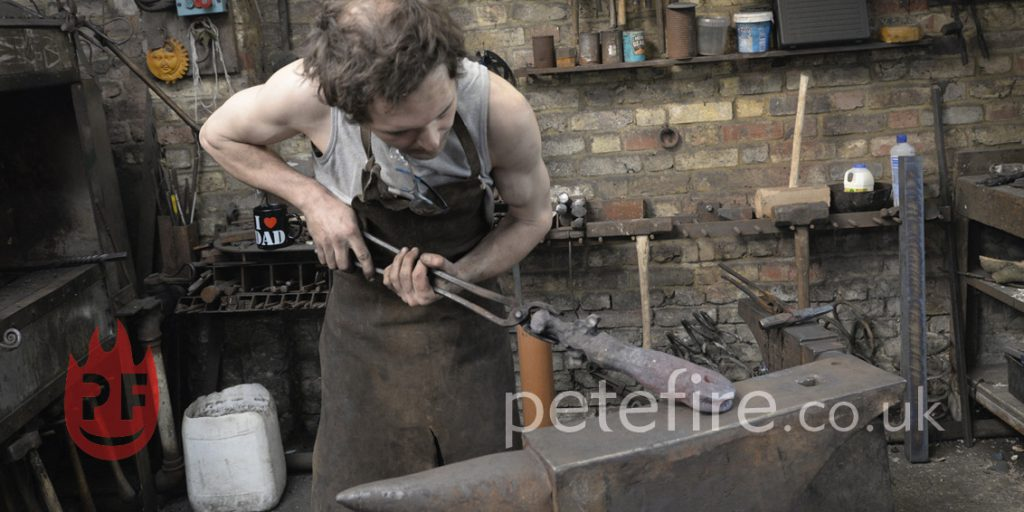 Blacksmith forging at the Herts forge