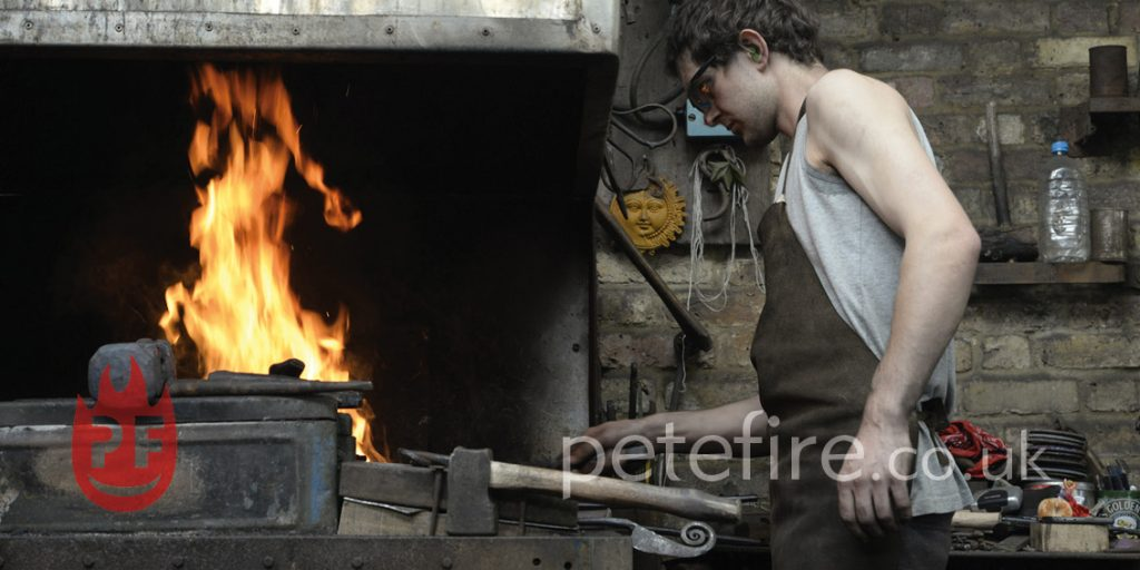 Blacksmith forging at the Petefire forge